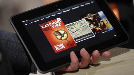 Peter Larsen, head of Kindle products for Amazon.com, holds a Kindle Fire HD tablet at a news conference in Santa Monica, California.