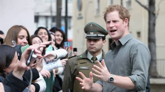 Prince Harry meets members of the public outside Valpariso Firestation on June 28, 2014 in Valpariso, Chile.