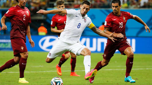 Clint Dempsey of the U.S. (C) attempts to score between Portugal's Bruno Alves and Ricardo Costa (R) during their 2014 World Cup G soccer match in Manaus, Brazil,  June 22, 2014.
