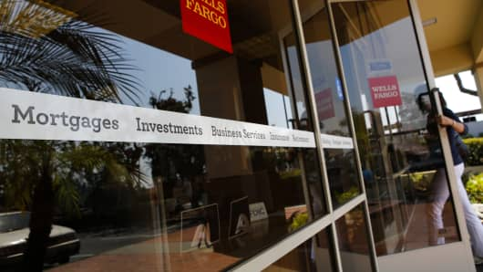 A customer enters at a Wells Fargo branch in Hermosa Beach, California.