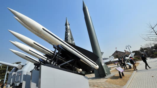 Visitors walk past replicas of a North Korean Scud-B missile (R) and South Korean Hawk surface-to-air missiles (L) at the Korean War Memorial in Seoul.