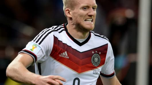 Germany's Andre Schurrle reacts after scoring a goal during the 2014 FIFA World Cup Brazil match between Germany and Algeria on June 30, 2014 in Porto Alegre, Brazil.