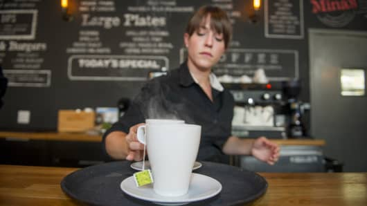 Kristin Ezell prepares tea for customers at Mina's Mediterraneo, where she waitresses in Miami Shores, Florida.