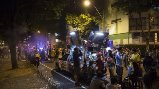 File Photo - Fans of the Brazilian football team buy food on the street from a mobile catering van after watching Brazil play Cameroon on June 23, 2014 in Belo Horizonte, Brazil.