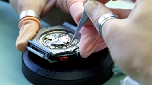 An employee assembles a Hublot wristwatch case at the company's headquarters in Nyon, Switzerland,