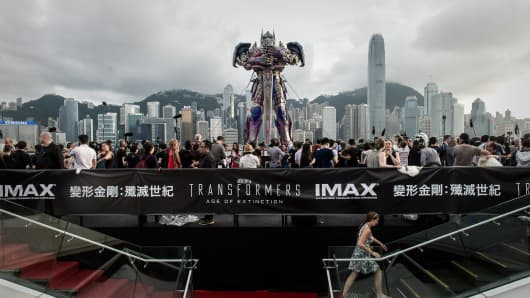 "A 20 foot-tall Optimus Prime figure stands along Tsim Sha Tsui at the world premiere of Hollywood movie ""Transformers 4"" in Hong Kong, China."