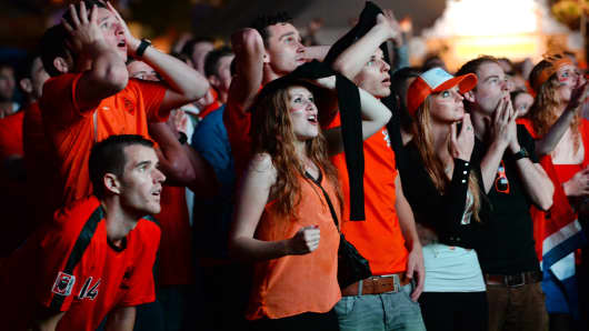 Dutch supporters watch on a big screen the FIFA World Cup 2014 quarter final match between the Netherlands and Costa Rica in Eindhoven, the Netherlands, on July 5, 2014.