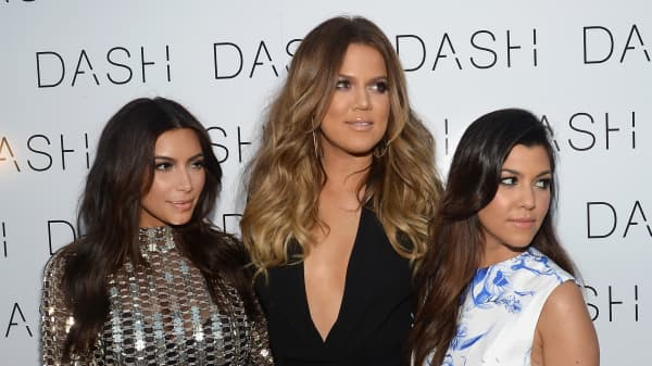 Kim Kardashian, Khloe Kardashian and Kourtney Kardashian on March 12, 2014 in Miami Beach, Florida.