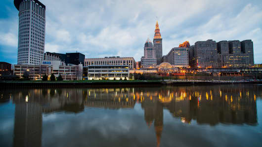Buildings in the downtown skyline are reflected in the Cuyahoga River in Cleveland, Ohio, April 12, 2014.