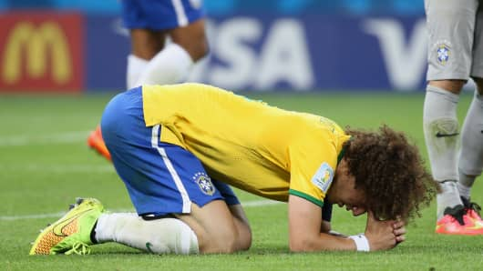 A dejected David Luiz of Brazil after the 2014 FIFA World Cup Brazil Semi Final match between Brazil and Germany on July 8, 2014 in Belo Horizonte, Brazil.