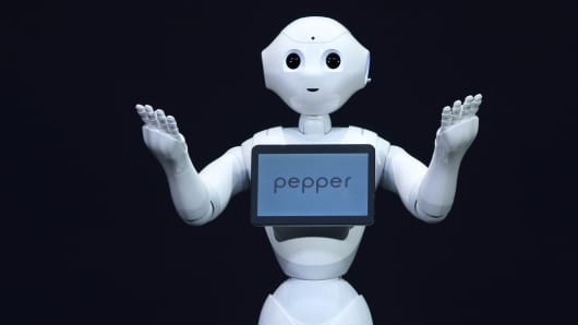 A human-like robot called Pepper, developed by SoftBank Corp.'s Aldebaran Robotics unit, gestures during a news conference in Urayasu, Chiba Prefecture, Japan.