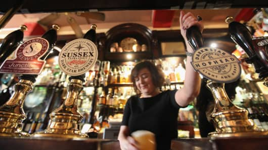 A barmaid pulls a pint in The Harp pub on the day it was named as the Campaign for Real Ale's national pub of the year on February 16, 2011 in London, England.