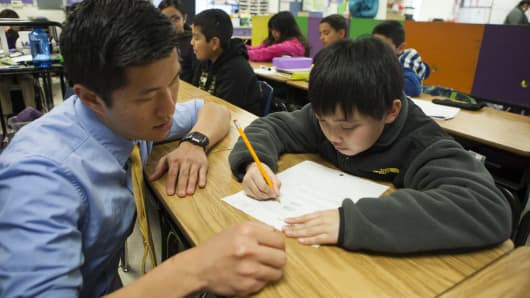 Fifth grade science and math teacher Stephen Pham helps a student at Rocketship Sí Se Puede Academy, in San Jose, California.