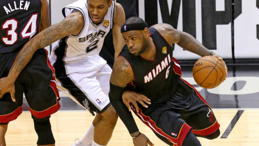 LeBron James of the Miami Heat drives around Kawhi Leonard of the San Antonio Spurs in Game Five of the 2014 NBA Finals in San Antonio, Texas.