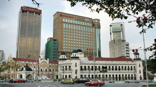 The headquarters of CIMB Bank (left) and OCBC Bank stand in Kuala Lumpur, Malaysia.