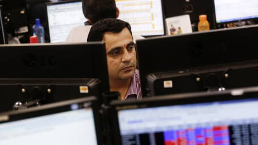Traders work on the trading floor of the Motilal Oswal Financial Services Ltd. office in Mumbai, India.