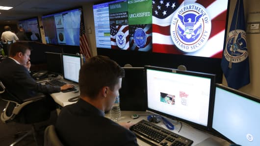 Department of Homeland Security employees work inside the National Cybersecurity and Communications Integration Center in Arlington, Va.