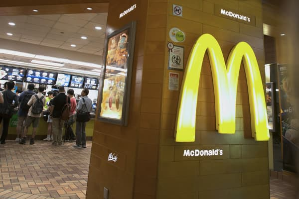 Customers stand in line at a McDonald's restaurant in Hong Kong.