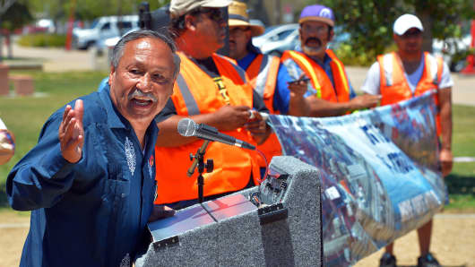 United Farm Workers President Arturo Rodriguez throws in his support of striking truckers at a press conference in Wilmington, Calif.