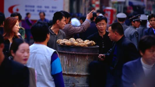Baked potatoes for sale in Dashilan Market in Xuanwu, Beijing.