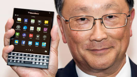 BlackBerry Chief Executive John Chen holds the Blackberry Passport during the company's annual general meeting for shareholders in Waterloo, June 19, 2014.