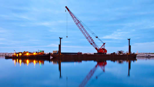 A Manitowoc crane on a tug and barge near Milwaukee, WI.
