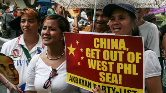 A group of protesters chanting slogans against the Chinese incursions within the West Philippine Sea.