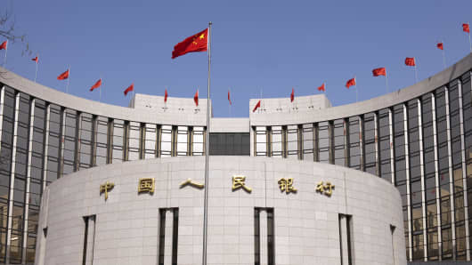 The Chinese flag flies outside the headquarters of the People's Bank of China in Beijing.