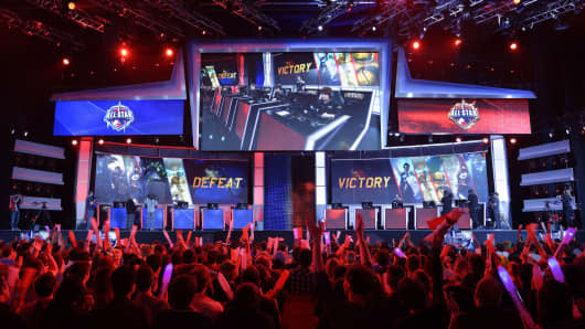 Visitors cheer for international teams during the tournament of the computer game 'League of Legends' on May 8, 2014 in Paris.