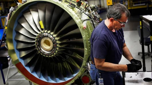 A mechanic works on a jet engine at General Electric's GE Aviation factory in Cincinnati.
