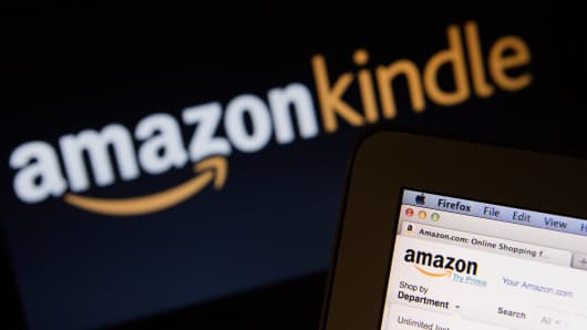 The Amazon.com homepage and Amazon Kindle logo