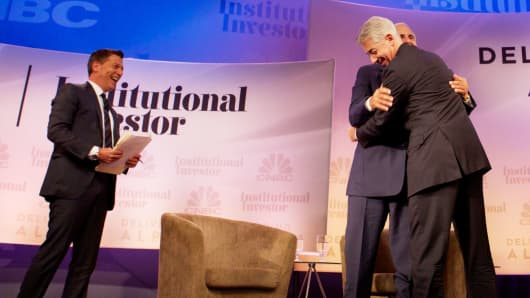 Bill Ackman hugs Carl Icahn during the 2014 Delivering Alpha conference in New York City.