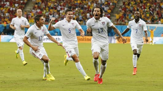Jermaine Jones of the U.S. celebrates with Alejandro Bedoya (11), Matt Besler (5) and DaMarcus Beasley after scoring a goal during the 2014 World Cup G soccer against Portugal at the Amazonia arena in Manaus, Brazil.
