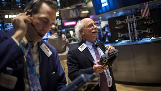 Traders work the floor of the New York Stock Exchange in New York.