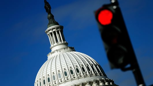 A traffic light is seen in front of the Capitol building in Washington.