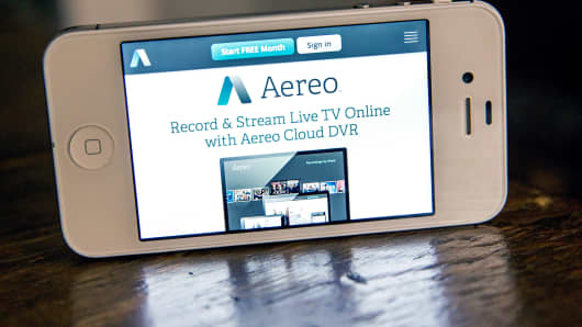 Aereo.com, a web service that provides television shows online, is shown on an iPhone 4S in New York.