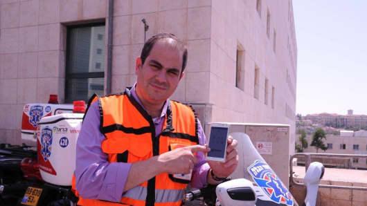 """Eli Beer, founder of United Hatzalah, with """"SOS"""" emergency response app"""