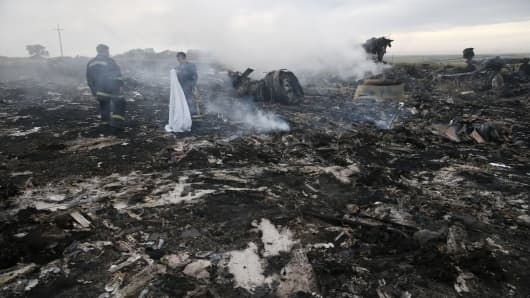 Emergencies Ministry members gather at the site of a Malaysia Airlines Boeing 777 plane crash near the settlement of Grabovo in the Donetsk region, July 17, 2014.