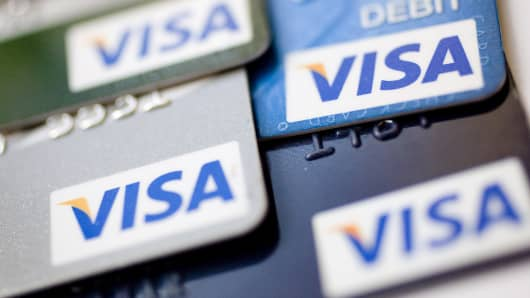 Visa credit and debit cards are arranged for a photograph in New York.