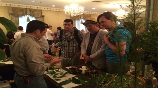 Forager Brian Early walks Tales attendees through finds from a recent tour in New Orleans.