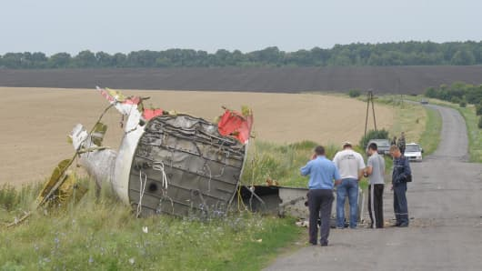 A part of plane is seen amongst the wreckages of a Flight MH17 after it was downed close to Russia's border near the town of Donetsk, Ukraine.