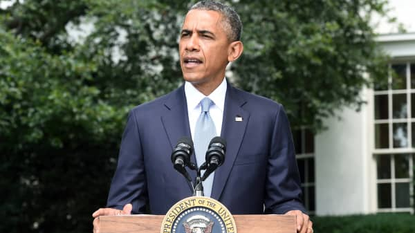 President Barack Obama speaks to the press outside the Oval Office at the White House in Washington, July 21, 2014.