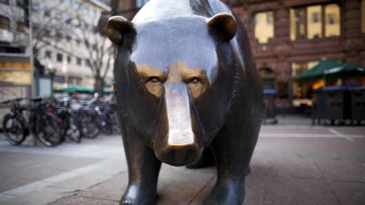 A statue of a bear stands outside the Deutsche Boerse in Frankfurt, Germany.