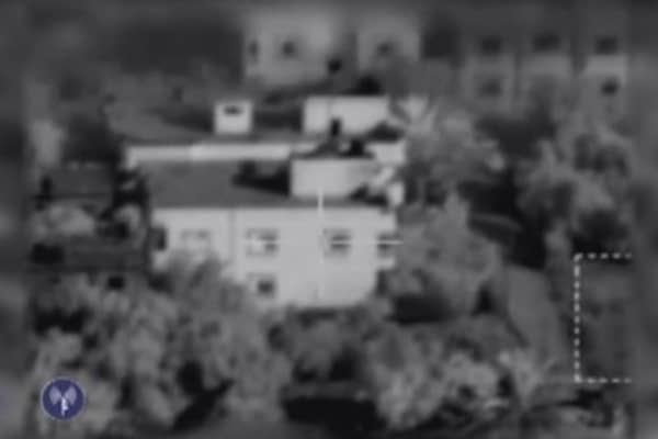 Hamas gunmen firing from the windows of a home