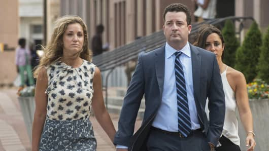 Former Jeffries Group LLC trader Jesse Litvak arrives at federal court in New Haven, Conn., along with wife Renee, July 23, 2014.