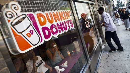 A customer enters a Dunkin' Donuts store in New York.