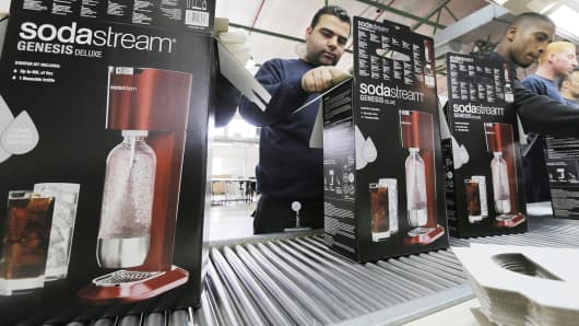 Employees pack boxes of SodaStreams at the factory in the West Bank Jewish settlement of Maale Adumim.
