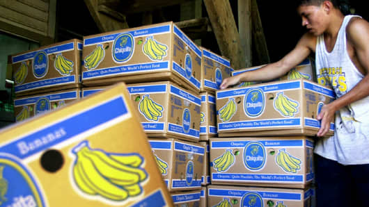 Sergio Medina carries boxes in the Chiquita banana packing plant located on the Bueso plantation in La Lima, Honduras.