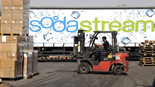 An employee uses a forklift to prepare pallets of SodaStream products for export at the SodaStream International factory in Mishor Adumim, Israel.