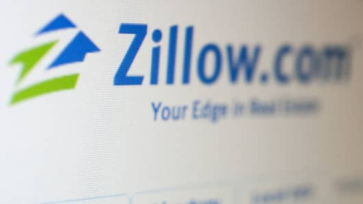 The homepage of Zillow.com is displayed on a computer screen in Washington.